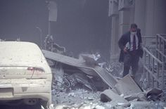 Sept. 11, 2001 - A survivor makes his way out of the rubble...