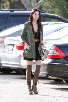 Love the trench with the dress and long stockings worn by Megan Fox.