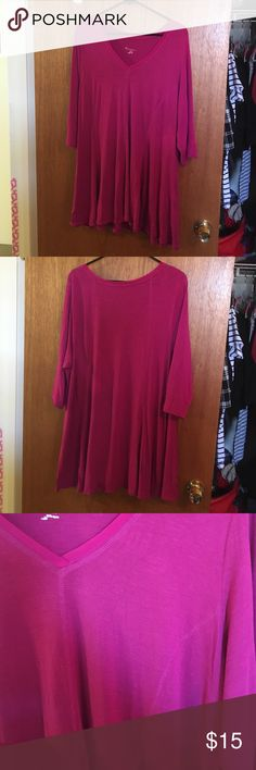 ✨VALENTINES SALE ✨ Magenta Tunic Magenta V neck tunic with flared sides. Great for layering with leggings and a belt! Three quarters sleeves and a light edging around the neck and princess seams. Reasonable offers considered! Lane Bryant Tops Tunics
