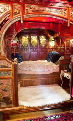 Too much red for me. Don't think I could sleep here with the loud colors, but I love the woodwork and the cozy feel of it.