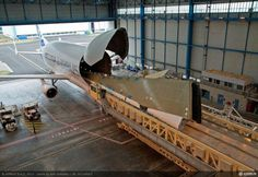 Airbus A350Wing. Being loaded into BELUGA, or perhapse unloaded at Toulouse[French words painted on tarmac]