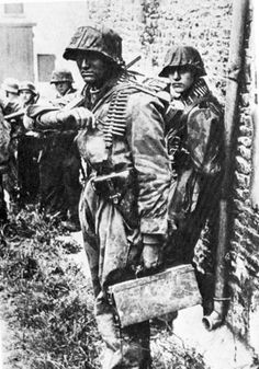 """Heavily armed youths of the 12th SS Panzer (Hitler Jugend) Division ready themselves for battle. The division, which consisted mainly of teenage volunteers, was created in June of 1943 and had its baptism of fire in Normandy a year later. - """"The young S.S. troops were detestable young beasts,"""" a British officer recalled, """"but, like good infantry, they stood up and fought it out when overrun."""" - In the fighting that raged around Caen, nearly 90 per cent of them were killed, wounded or…"""