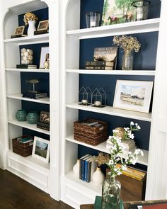 The blue's not bad without the glass doors/shelves. White built-in book shelves, navy paint from Built In Shelves Living Room, Bookshelves In Living Room, Decorating Bookshelves, Bookshelves Built In, My Living Room, Living Room Decor, Book Shelves, Glass Shelves, Bookcase White