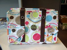 The Circle Spirals Organizing Utility tote is A-MAZING!  I love the pattern and obviously the OUT is the best selling product!  The uses are endless!  Caitlin (written in lime green) just got it to use as a purse!