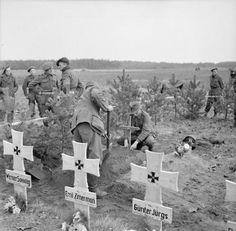 POWs captured by 51st Highland Division bury and mark the graves of German dead, 1 November 1944.