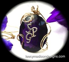 200 ct lab grown amethyst socer's stone with your initials and 18kt gold wire wrap.