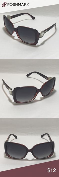 Maroon/Silver Ladies Bling Sunglasses 1 Pair of Bling Accented Ladies Sunglasses    Maroon Frame    Black Lenses    Silver Accents with Bling    High Quality    100% UV Protection    Women  1 Black Microfiber Pouch  Ships: Within 24 hours of purchase Mon-Sat. Orders on Sundays/Holidays ship next business day.  ShadeME - 9155 Accessories Sunglasses