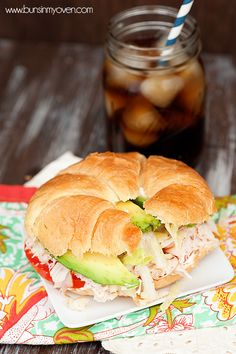 The Gobbler - a unique recipe for a turkey sandwich. INGREDIENTS: 1 croissant per sandwich shaved deli turkey breast (I prefer honey roasted) cream cheese fresh tomato slices avocado slices shredded lettuce salt and pepper, to taste Cookie Sandwich, Croissant Sandwich, Soup And Sandwich, Sandwich Recipes, Lunch Recipes, Appetizer Recipes, Cuban Sandwich, Sandwich Ideas, Recipes Dinner