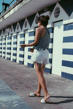 Summer outfit wearing white ripped shorts #beachwear