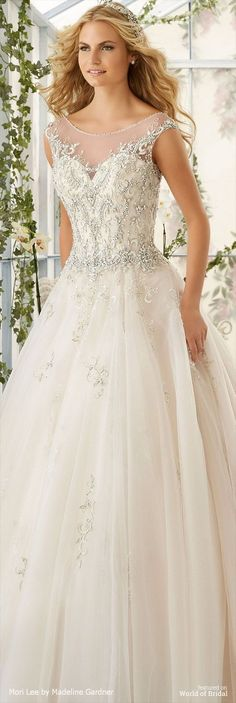 Intricate Crystal Beaded Embroidery Decorates the Tulle Ball Gown