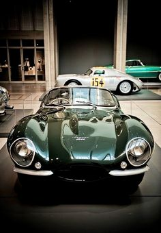 1957 Jaguar XKSS Sports Car Roadster | 3.8L Straight 6 propels this knobbly to speeds reaching around 170 mph | Street Legal Version of the Jaguar D-Type Racing Car | Only 16 units were produced | A notable owner was Steve McQueen who called his British Racing Green XKSS the Green Rat