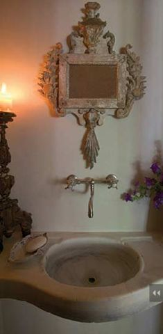 Such a wonderful old sink... and oh how I want this mirror!