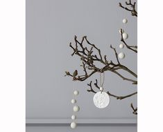 [[start tab]] INFO Aarikka Kuusenkoru Tree Decoration in White wood. Charming Christmas decoration for the tree made with wooden beads on cord. 100% maple wood.