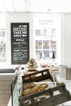 """Love the clean, fresh white walls. And the sign """"If you cant stay, take me [home]>>"""" The rustic box on dispaly is mighty cute, too."""