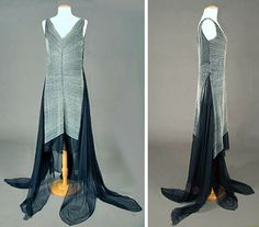 Beaded French evening gown ca. 1929. Black silk georgette, trained, sleeveless gown, front & back embroidered with hundreds of rows of tiny white beads & center vertical row of square diamante. Long draping panels of georgette from hip to floor ending in handkerchief points. Dress reputed to have been fashioned in France from Erté pattern. Augusta Auctions
