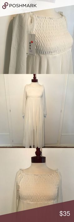 """NWT Boho White Ruffled Long Sleeve Chiffon Maxi NWT White Ruffled Long Sleeve Chiffon Maxi Dress with Shirred Top and Empire (High) Waist.   Very stretchy at the chest and waist. Lined skirt. Puffed sleeves. Originally from yesstyle.com! It's a Korean brand!✌️  I had originally bought this as my wedding dress for my boho wedding but it was too hot in LA in September for long sleeves, so I bought another dress! My loss, your gain!💕  Length: 49"""" Dresses Maxi"""