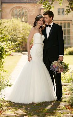 Curve-hugging linear lace on a plunging bodice make this fit-and-flare wedding dress from Essense of Australia a top pick for the perfect wedding. See all the details.