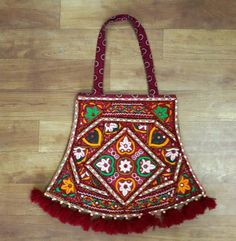 These Bag are comprised of Kutchiwork, Pakko embroidered work, vintage ethnic flower patchwork pakkowork, Pakkowork. We have a small manufacturing unit in Gujarat. We manufacture vintage banjara fabric products like clutch, shoulder bag, traditional kurti, ladies jackets.