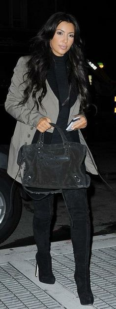 Who made Kim Kardashian's black thigh high boots, black suede purse, black turtle neck and jacket that she wore in New York? Shoes – Brian Atwood  Purse – Balenciaga  Shirt – American Apparel  Jeans – Citizens of humanity  Jacket – Jamison Grayson