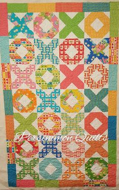 Xs & Os quilt made by Cathi. Long arm quilted by Le Ann Weaver of www.persimmonquilts.com