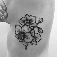 Some Orchids on her ribs !! Your custom desing request are welcome. Done @olyangertattoo