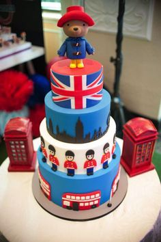 Searching for a practically perfect Paddington Bear birthday party? Kara's Party Ideas has the ideas for this British bear's best events. England Cake, England Party, British Party, London Party, London Cake, Bear Birthday, Birthday Cake, Paddington Bear Party, Bear Cakes