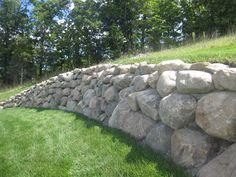 4' boulder retaining wall http://squeezepagecreator.com/video/creator/new_site/727200/