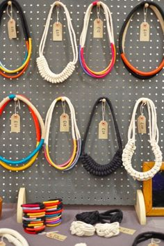 Painted pegboard makes a perfect backdrop for displaying Peggy's rope and thread necklaces at the Weekend of the Maker.