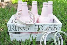 What could be more perfect for a wedding than a ring toss? Paint used bottles in your wedding colors, arrange in a wooden crate, and decorate embroidery hoops with pretty fabrics (get the how-to here).Photo Credit: Two Shades of Pink