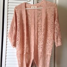 Open front lace cardigan!! Cute open front lace cardigan!! Never wore! All new! Light pink color..can b wear on tank top..price is firm! Pink Rose Sweaters Shrugs & Ponchos
