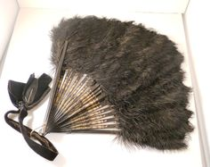 An antique ostrich feather fan. Haha this is kind of cool :) Antique Fans, Vintage Fans, Flapper Accessories, Raven Feather, Christmas Party Themes, Hot Flashes, Ostrich Feathers, Simple Elegance, Shadow Box