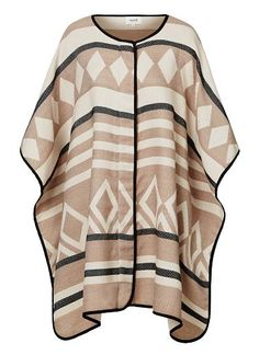 Printed poncho with front zip and press stud closure under arms. One Size. Acrylic.