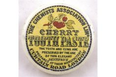 CHERRY TOOTHPASTE POT LID. 2.75ins diam, black transfer on yellow background THE CHEMISTS ASSOCIA