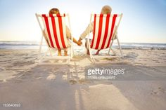 couple holding hands sitting on deckchairs - Google Search