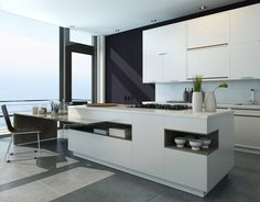 Modern white kitchen island with attached dining area and open plan layout.