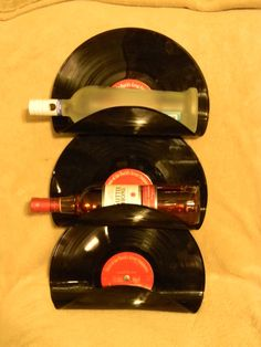 Wall Mounted Vinyl Record Wine Rack by HandmadeMolly on Etsy, $30.00