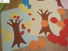 Ritaglia tanti cerchi colorati, nel nostro caso con i colori dell'autunno