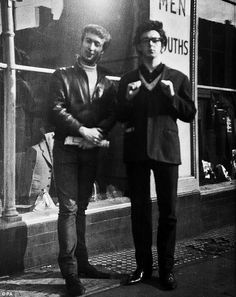 Friends John Lennon and Paul McCartney pose on the streets of Liverpool before fame and moptop hairstyles take hold, in a previously unpublished photo.