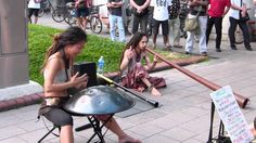 Yuki and Taku in Singapore Yuki plays a Spacedrum made in France. Taku accompanies her with a Didgeridoo from Australia.