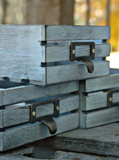 DIY: How to Get this Weathered Finish - using stain and spray paint, these new craft store crates were given an aged finish - via Little House of Four