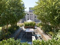 23 lavish rooftop garden with potted trees and plants - Shelterness