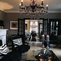 Black and silver and gray living room design, Gothic black chandelier. Beautiful sitting room with French doors. Scratch the Zebra pillows Living Room Grey, Interior Design Living Room, Living Room Designs, Living Room Decor, Bedroom Decor, Black And Silver Living Room, Small House Decorating, Decorating Ideas, Decor Ideas