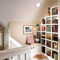 Aha! Better Homes & Gardens brings us more space for a library in a room with a slanted ceiling--with a bench where you can sit and read. Notice the extra storage under the bench. Nice!