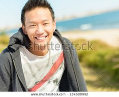 Portrait Of Happy Young Asian Man; Outdoors