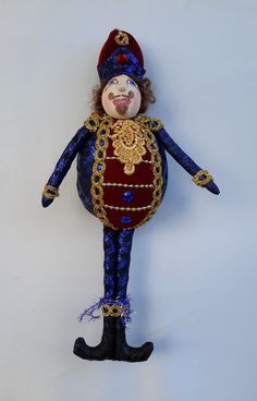 NUTCRACKER, a JOYFUL JOLLY in Blue and Red, Hanging Ornament Doll Designer ornaments to decorate your home or as a beautiful, unique gift.  This gorgeous, Art Doll Ornament is made with the finest materials, beads, trims and braids. Hand painted with acrylics, my Joyful Jollies range is