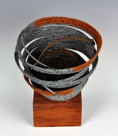 loose and tightly coiled  waxed linen, found metal  coiling, assembledge