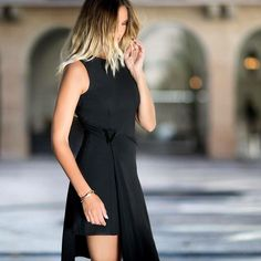 The Versace little black dress. @NinaSuess shows us how to style with attitude. #7D7D Find your dress on shop.versace.com
