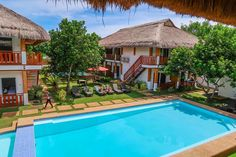 The Scent of Green Papaya Dive Resort Panglao offers peaceful and comfortable accommodation with free WiFi access throughout the property. It features an outdoor pool, front desk and free p… Dive Resort, Green Papaya, Outdoor Pool, Outdoor Decor, Bohol, Beach Resorts, Tour Guide, Front Desk, Places To Travel