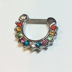 Popular and pretty Septum Clicker.   FAST SHIPPING!    This small piece (about 14mm x 12mm) features:   Rhodium plated base with stainless steel