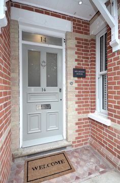 Red brick entrance porch, Edwardian front door painted in Farrow & Ball - Hardwick White, Victorian floor tiles ready for refurbishment, re-pointed and cleaned brickwork. Polished Nickel door furniture from Willow & Stone. Cottage Front Doors, Grey Front Doors, Victorian Front Doors, Front Door Porch, Modern Front Door, Front Door Entrance, House Front Door, Painted Front Doors, Front Door Colors